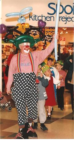 Clown Bluey leads the Easter Bonnet Parade, Marlands Shop Mall