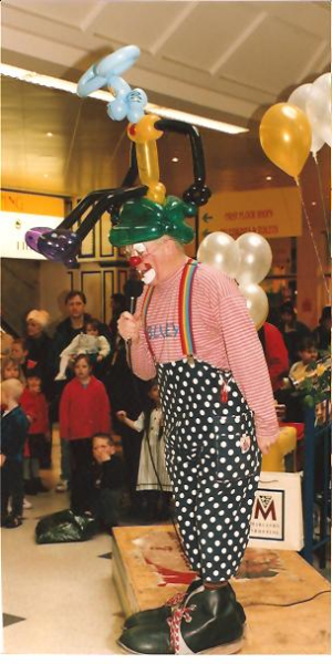 Clown Bluey on the mic at the Easter Bonnet Competition, Marlands Shop Mall
