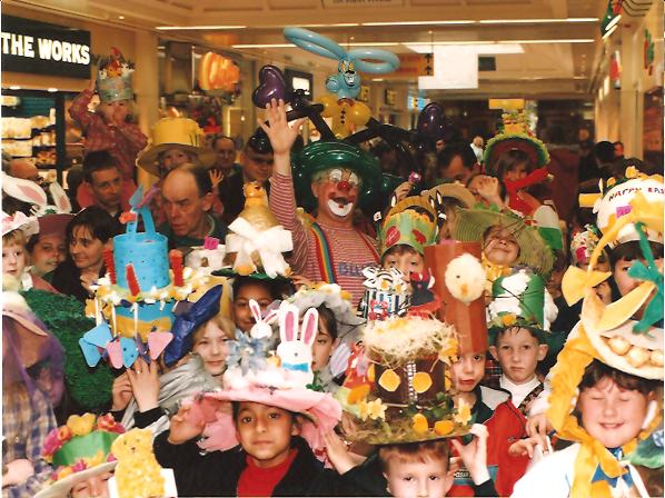Clown Bluey and some of the entrants at the Easter Bonnet Competition