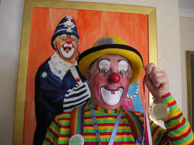Clown Bluey with the medallion received from HSH Princess Stephanie