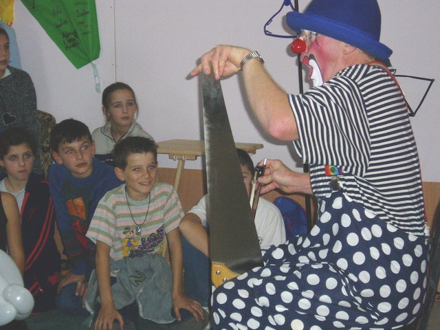 Bluey playing the saw, Kosovo, 2004