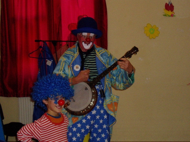Bluey playing the banjo, Kosovo, 2004
